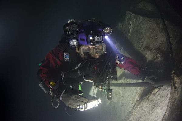 """Krzysztof Starnawski first dived in the cave 20 years ago. Now, he led the team that found that """"Hranice Abyss"""" is the world's deepest underwater cave. Credit: Marcin Jamkowski/National Geographic"""