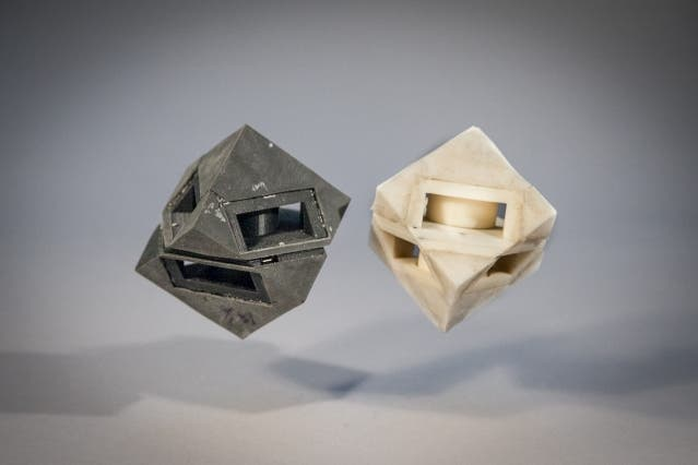 This SciFi looking robot cube was fitted with a 3-D printed skin which absorbs most of the energy the robot would have usually transferred to the ground. Credit: MIT