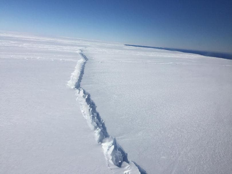 A rift in Pine Island Glacier ice shelf, West Antarctica, photographed from the air during a NASA Operation IceBridge survey flight, Nov. 4, 2016. This is the second rift to form on the ice shelf in the last couple of years. The first led into the break off a huge iceberg in 2015. Credit: NASA/Nathan Kurtz.