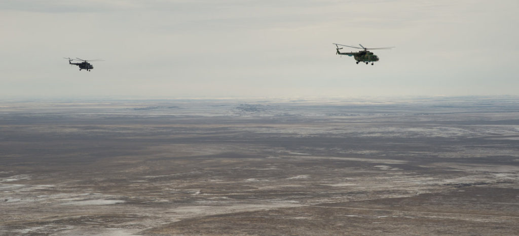 Russian search and rescue helicopters survey the drop site in anticipation for the astronauts' landing. Credit: Bill Ingalls/NASA