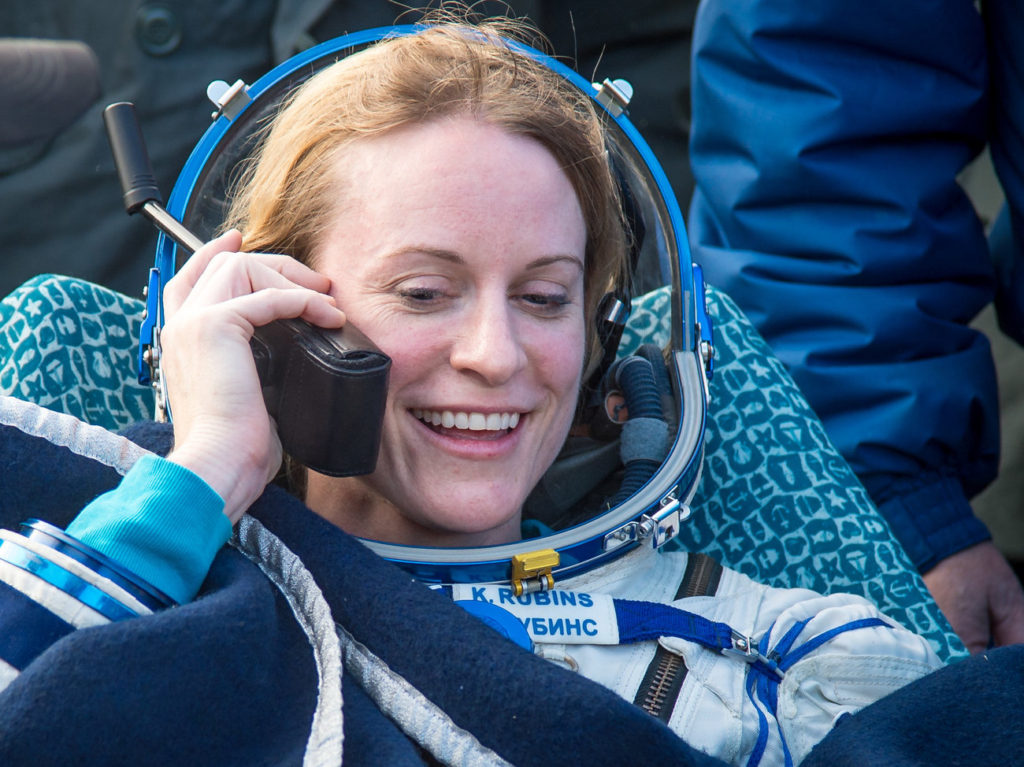 Astronaut Kate Rubins talks to her family on satphone shortly after she landed on Earth. Bill Ingalls/NASA
