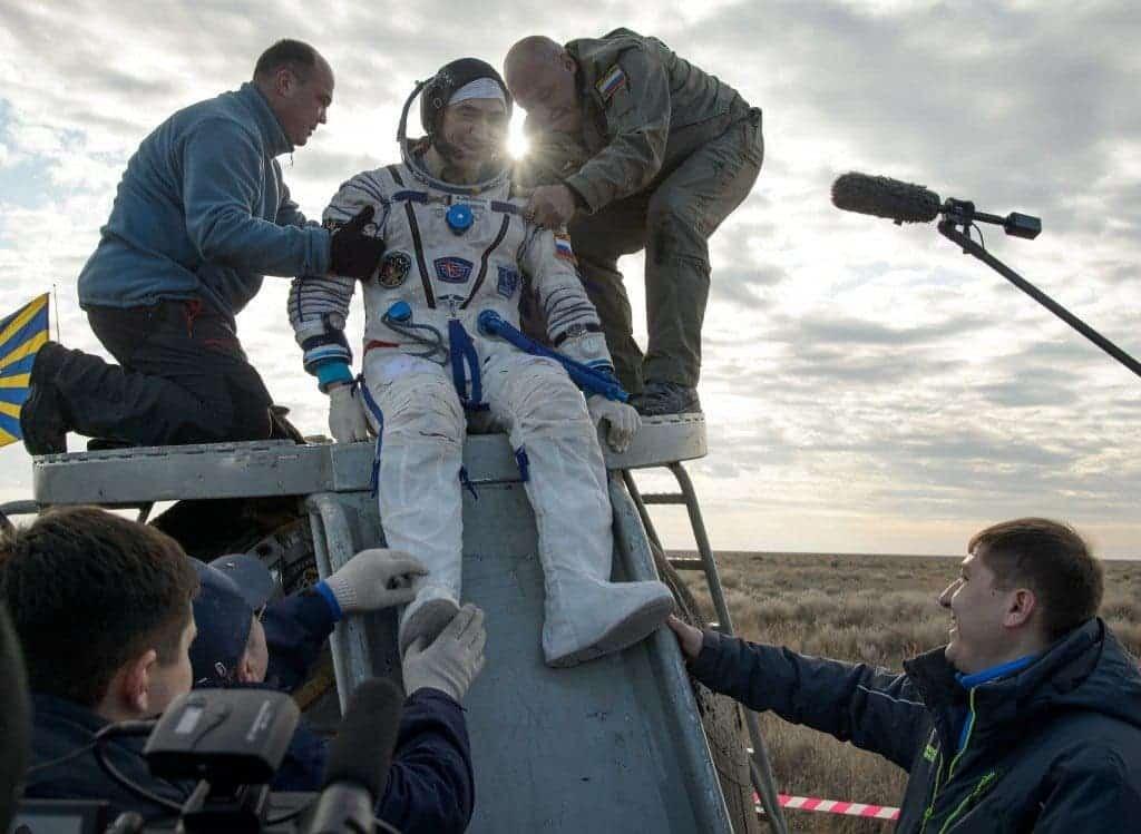 Anatoly Ivanishin exits the Soyuz spacecraft. Credit: NASA/Bill Ingalls