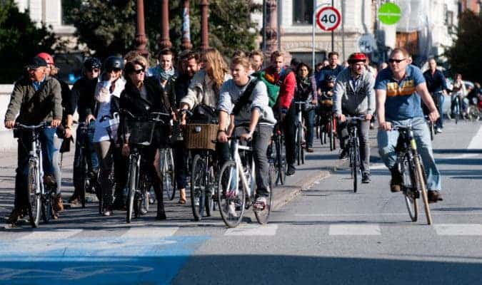 Cyclists in Copenhagen waiting for the green light. Credit: Wikimedia Commons