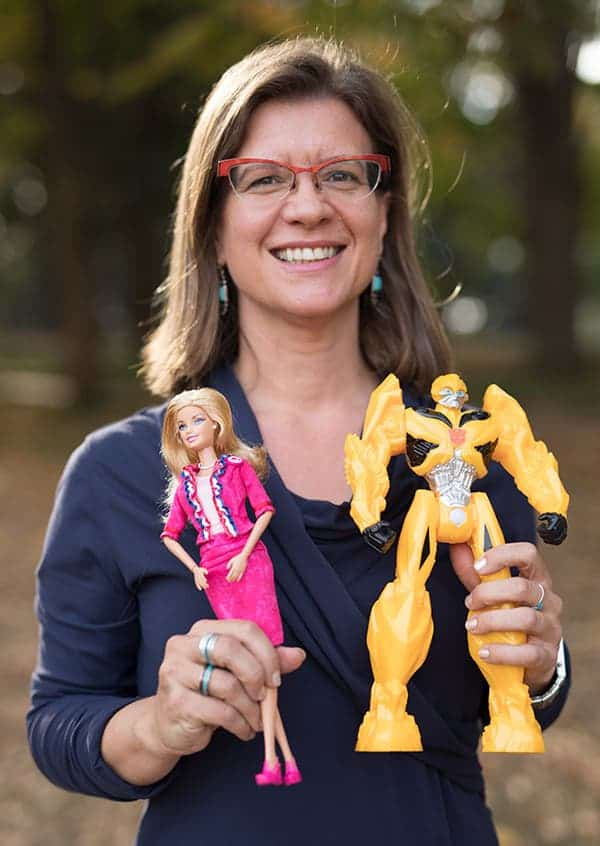 Isabel Gauthier holding the two toys used in her study. (John Russell / Vanderbilt University)