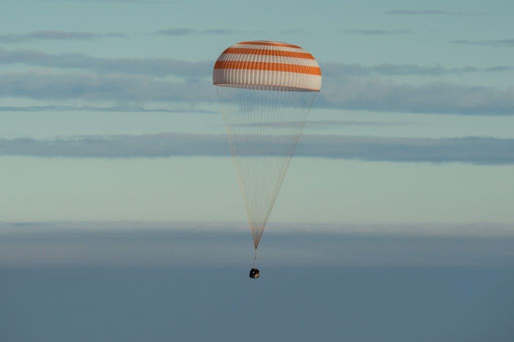 NASA astronaut Kate Rubins, Russian cosmonaut Anatoly Ivanishin of Roscosmos, and astronaut Takuya Onishi of the Japan Aerospace Exploration Agency (JAXA) touched down near the town of Zhezkazgan, Kazakhstan on Sunday. Credit: NASA/Bill Ingalls