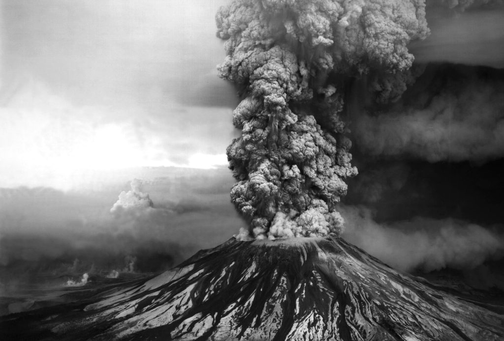 An ash plume billows from the crater atop Mount St. Helens hours after its eruption began on May 18th, 1980, in Washington state. Credit: USGS / Robert Krimmel