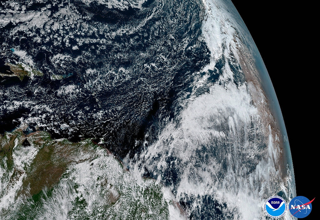 The Saharan Dust Layer can be discerned in the far right edge of this image of Earth. This dry air from the coast of Africa can have impacts on tropical cyclone intensity and formation. GOES-16's ability to observe this phenomenon with its 16 spectral channels will enable forecasters to study related hurricane intensification as storms approach North America. Credit: NOAA, NASA