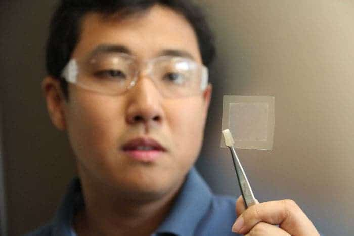 Dr Zhao Jun Han holds a thin film of graphene he made from soybean oil. Credit: CSIRO.