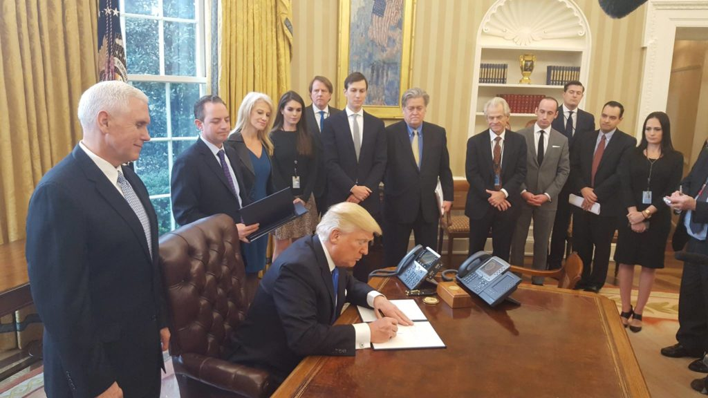 Donald Trump signs Executive Orders in January 2017. Credit: Wikimedia Commons.
