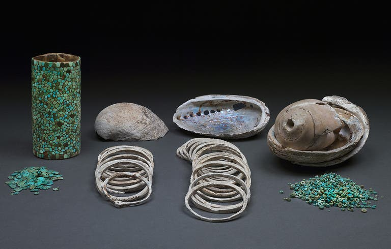 Some of the turquoise and shell artifacts found in Room 33 of Pueblo Bonito. Credit: Roderick Mickens.