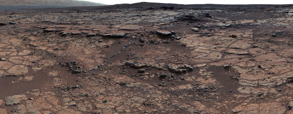 Bedrock inside Mars' Gale Crater. Curiosity retrieved and analyzed rocks from the site which indicate little carbon dioxide was present in the atmosphere. Credit: NASA/JPL-Caltech