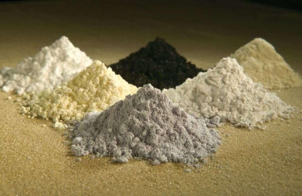 Rare earth elements are usually produced as oxides. Clockwise from top center: praseodymium, cerium, lanthanum, neodymium, samarium, and gadolinium.