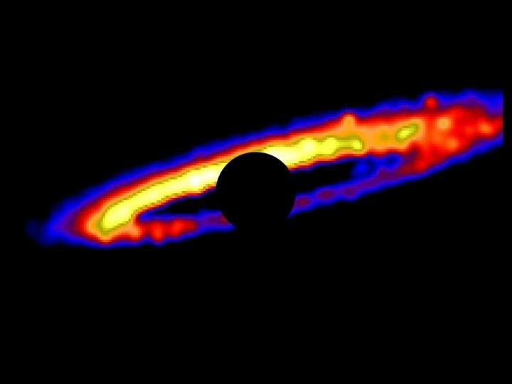 The stellar debris disk around HD 106906. This image was created using an innovative software designed at UCLA. The star itself is masked with a black circle and the various hues represent brightness gradients. Yellow is the brightest and blue the dimmest. Credit: Erika Nesvold/Carnegie Institution for Science