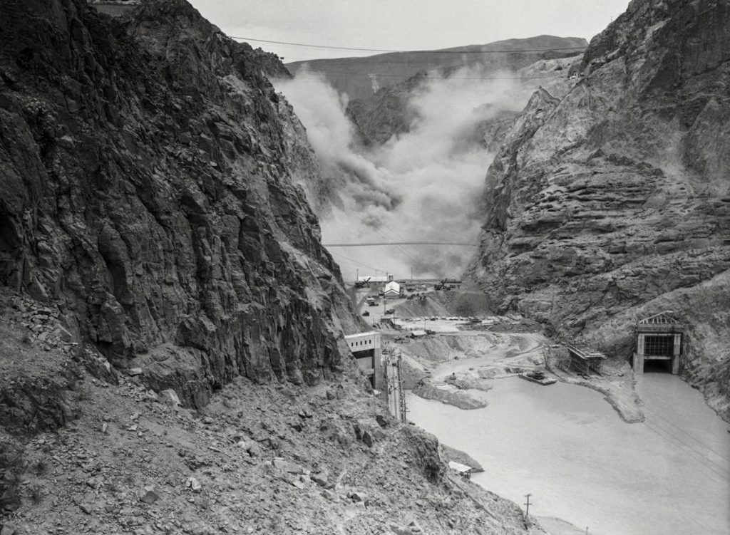 Dynamite is detonated in the canyon to make room for the new dam (1933). Credit: CORBIS.