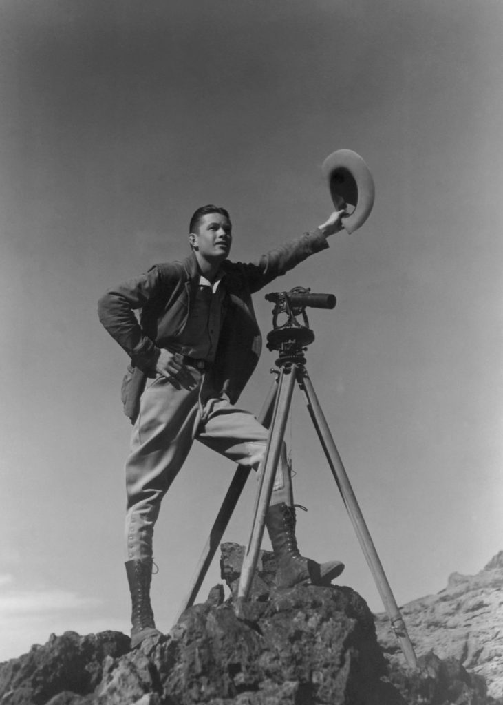 A surveyor signals to colleagues during the construction of the dam (1932). Credit: CORBIS.