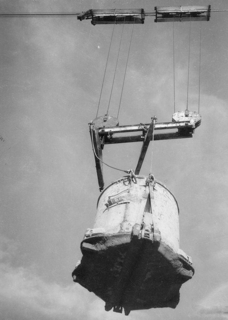 This bucket holds 18 tons of concrete (1934). Credit: CORBIS.