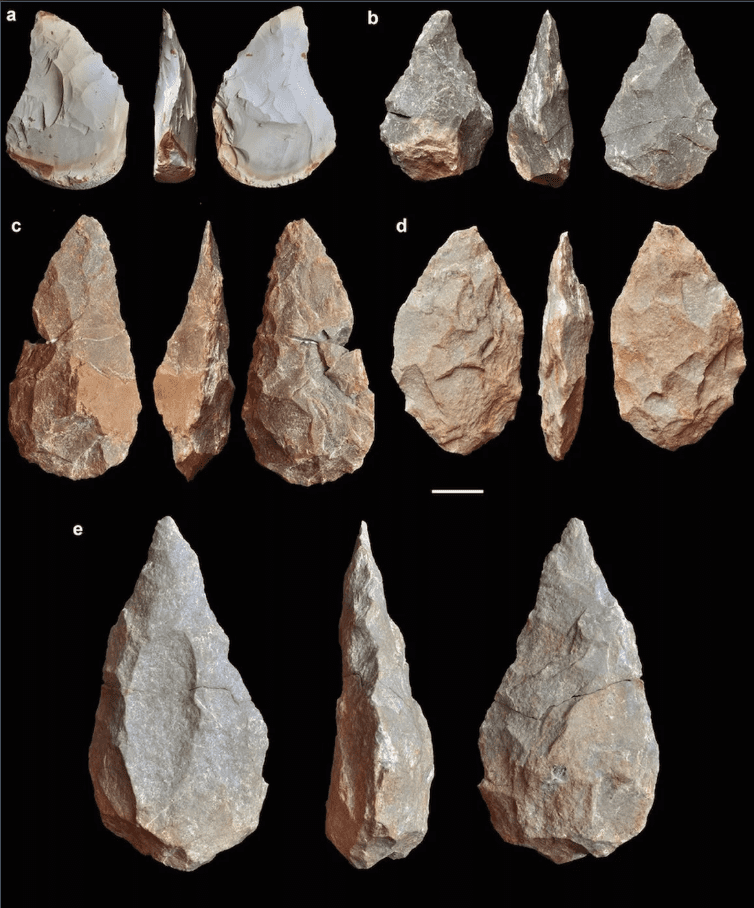 Hand axes crafted from stone discovered at the Aroeira site in Portugal. Credit: Rolf Quam.