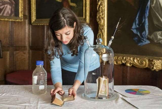 Heritage scientist Cecilia Bembibre samples the odor of a 18th century bible. Credit: National Trust / James Dobson.