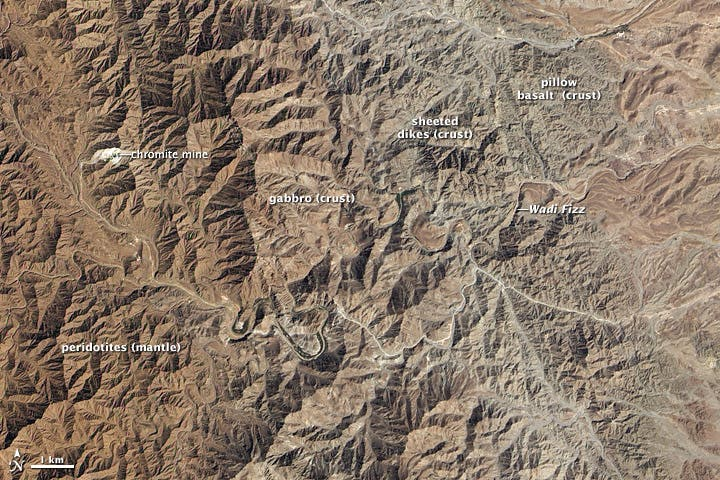 The Semail (or Samail) ophiolite landscape as seen in a 2012 NASA satellite image. Credit: NASA.