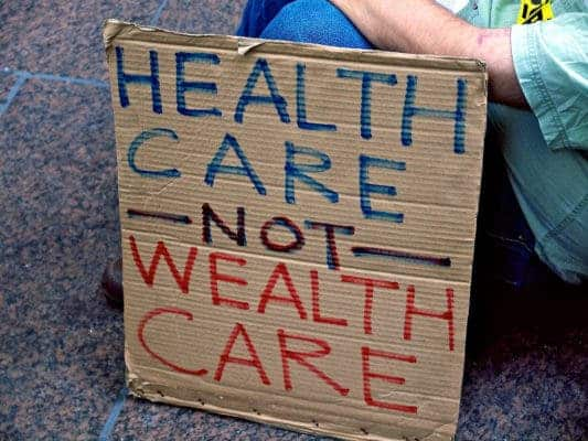 Healthcare not wealthcare sign.