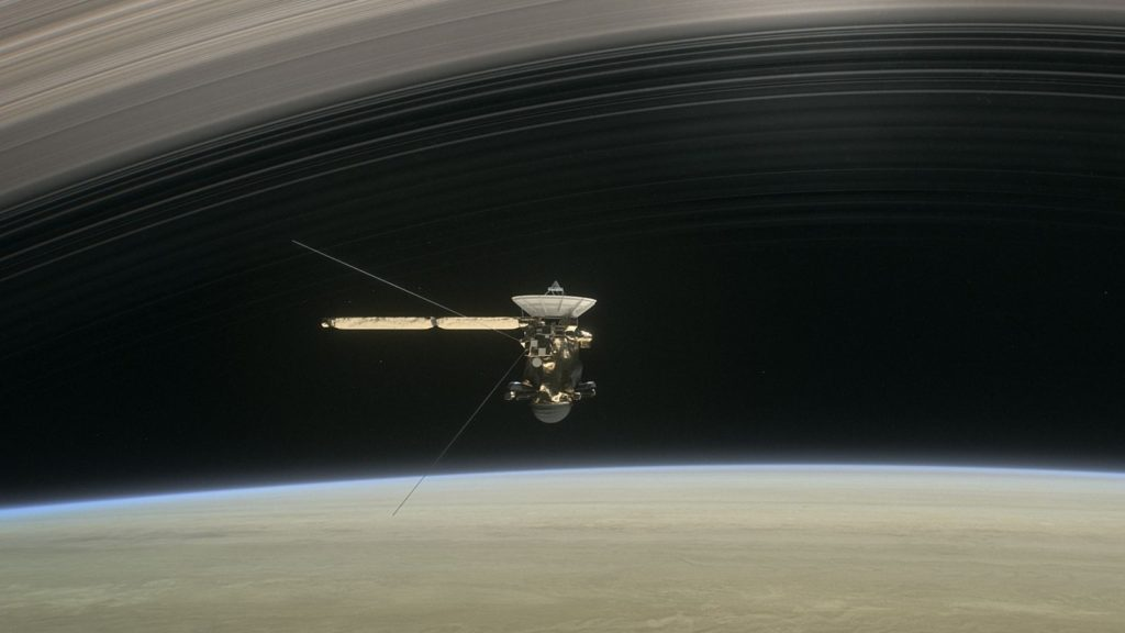 Artist illustration of Cassini diving through Saturn's rings. Credit: NASA.