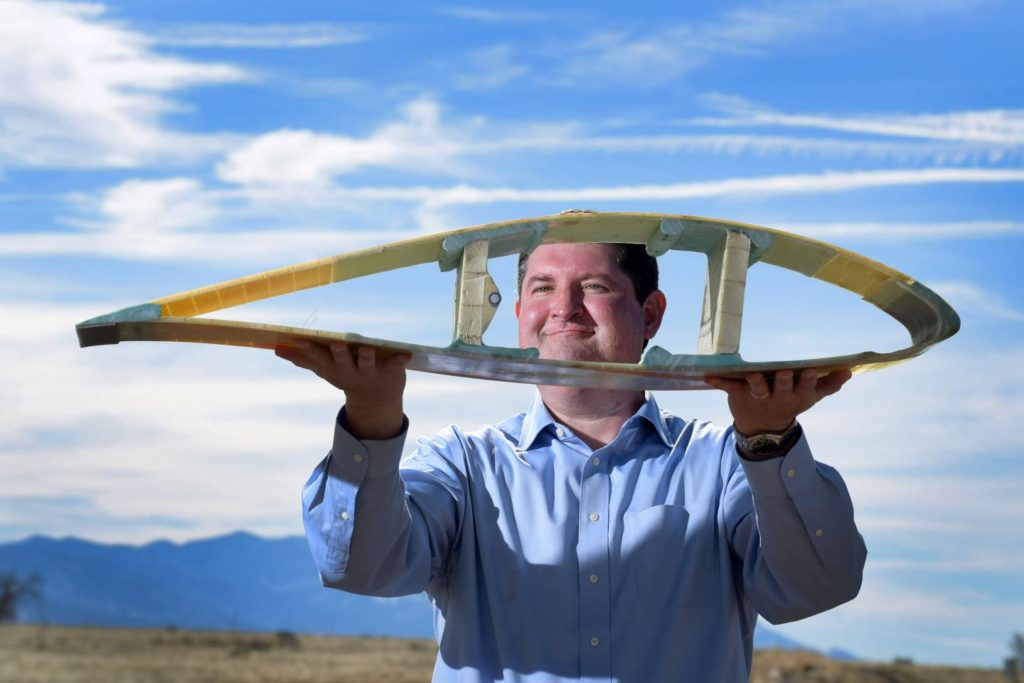 Todd Griffith shows a cross-section of a scaled down model of a 50-meter blade already in operation, which is part of the pathway to the 200-meter exascale turbines being planned under a DOE ARPA-E-funded program. Credit: Sandia.