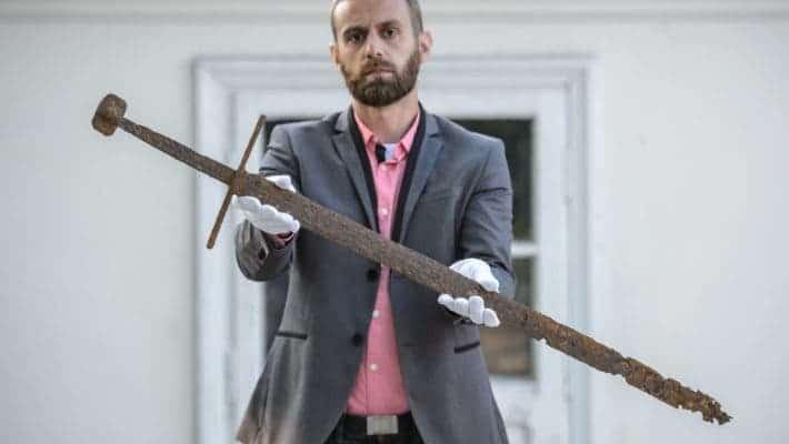 Bartłomiej Bartecki, director of the Museum in Hrubieszów presents the sword found in the Commune of Mircze. Photo: PAP/ Wojciech Pacewicz.