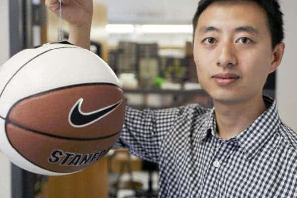 Hao Jiang, graduate student at Stanford shows a basketball being gripped by the gecko-inspired adhesive.