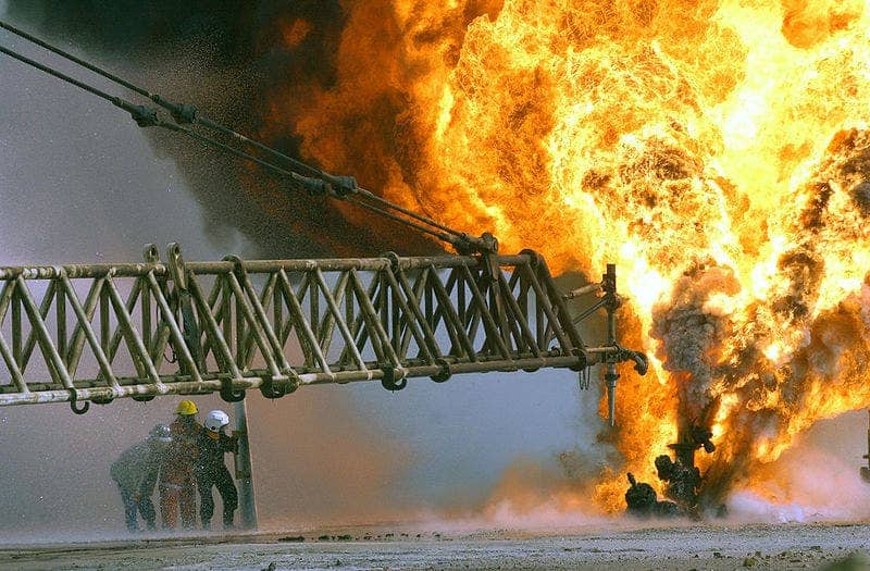 A burning oil well in the Rumaila oilfields, Kuwait.