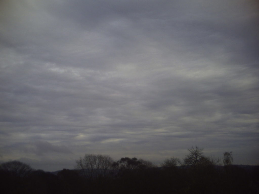 Altostratus clouds spelling a rainy day. Credit: Wikimedia Commons.