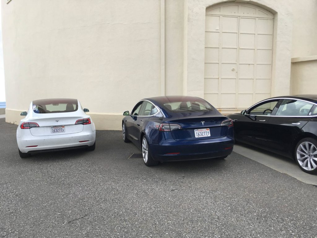 White, blue, and black Model 3s of an unknown version (not production). Credit: Credit: 'inamachineshop' Reddit user