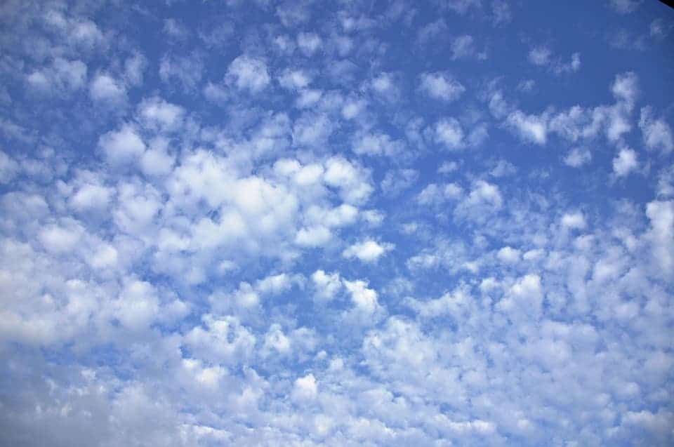 Altoculumus clouds are sometimes called 'social clouds' because they appear in groups. They have a grayish-white color with some portions darker than the others. Credit: Pixabay, MabelAmber.