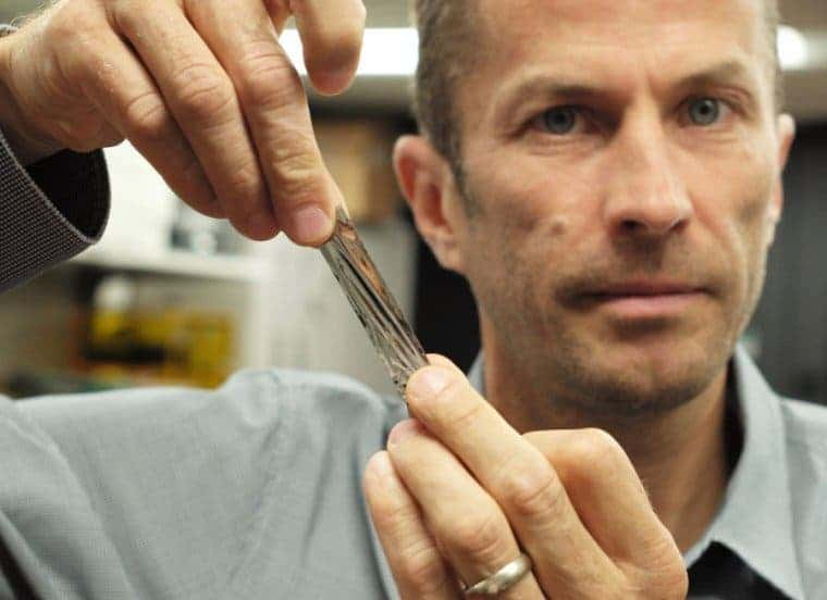 IBM scientist Dr. Mark Lantz, holds a single one square inch piece of tap, which alone can store 201 gigabytes. Credit: IBM Research.