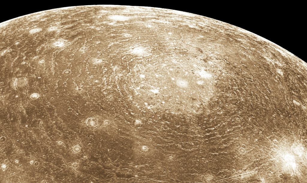 Voyager 1 image of Valhalla, a multi-ring impact structure 3800 km in diameter. Credit: Wikimedia Commons.