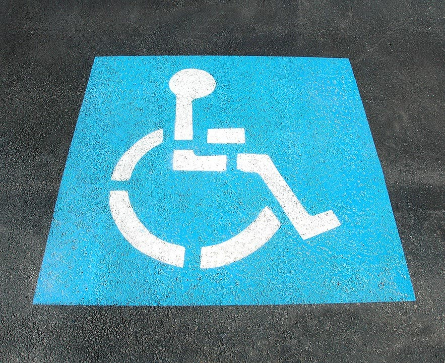 Parking sign wheelchair.