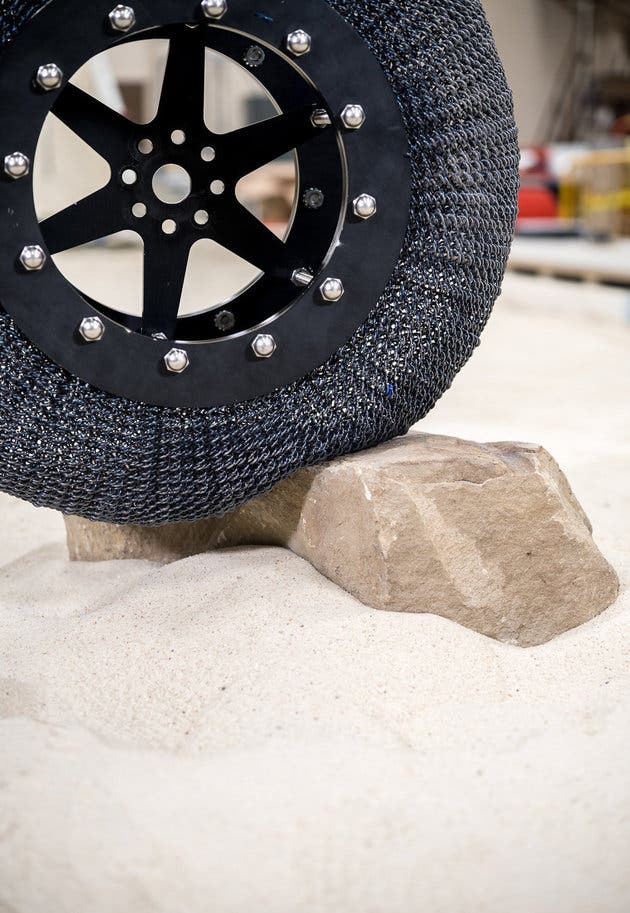 This is a recent SMA tire version that has dense coils, weighs about 20 lbs and can handle 165 lbs of load. Credit: NASA.