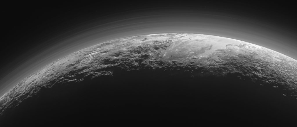 Plutonian landscapes in twilight, under a hazy sky. Credit: NASA/JHU APL/SwR.