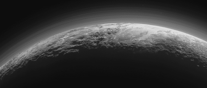 Plutonian landscapes in twilight, under a hazy sky. Credit: NASA/JHU APL/SwR.