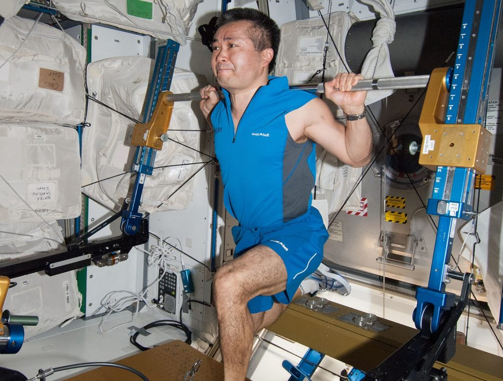 Astronaut performs kneeling lift with ARED device. Credit: NASA.