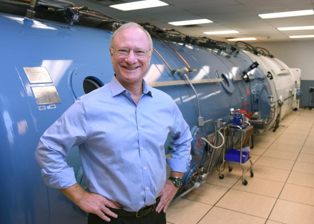 Dr. Levine, shown here in front of his laboratory's hyper/hypobaric environmental chamber which simulates performance in environments such as space or deep diving. Credit: UT Southwestern.