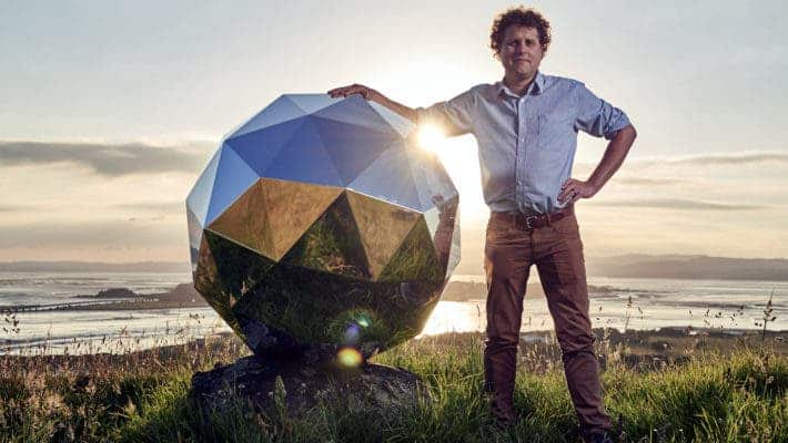 Rocket Lab founder and CEO Peter Beck next to the mirror-covered sphere his company sent into Earth's orbit. Credit: Rocket Lab.
