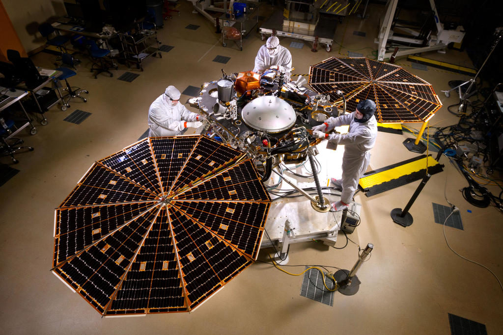 Technicians inspect InSight instruments. Credit: NASA.