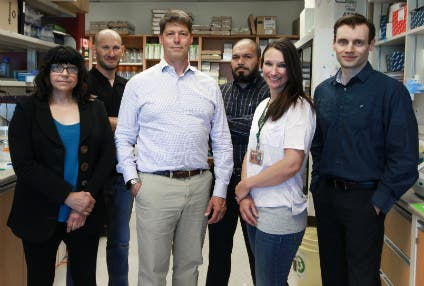 John Lewis (third left) and his research team. Credit: University of Alberta.