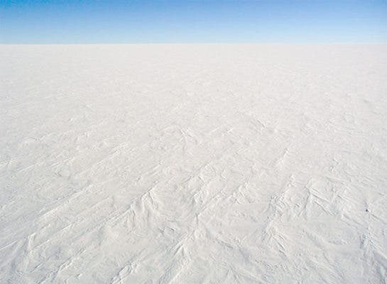 The high, flat, and cold environment of the Antarctic Plateau at Dome C. Credit: Wikimedia Commons.