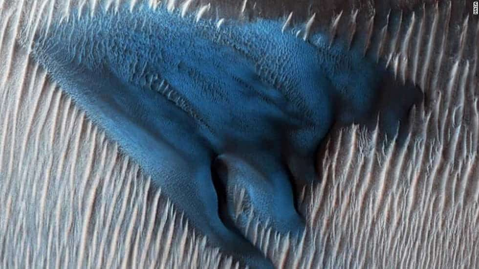 This big Martian due looks blue in this enhanced image. It is, in fact, gray. Credit: NASA/JPL-Caltech/University of Arizona.