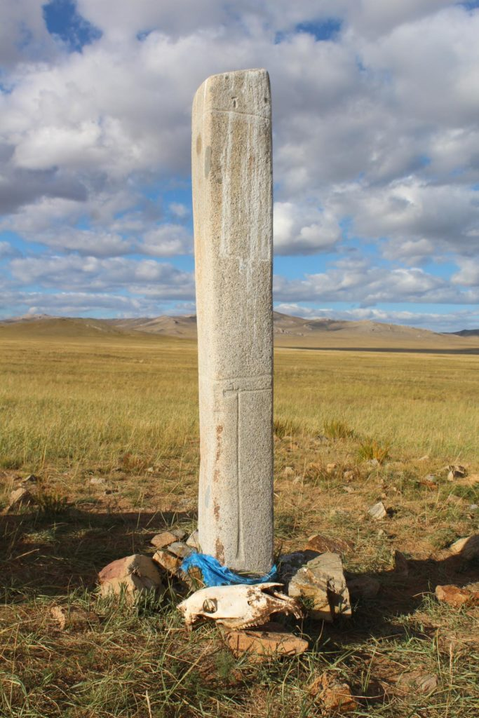 A horse skull placed next to a deer stone in central Mongolia. Ancient and modern Mongolian herders alike revere both. Credit: William Taylor.