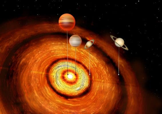 Illustration of CI Tau, which is surrounded by a planetary disc and has four gas giants orbiting around it. Credit: University of Cambridge.
