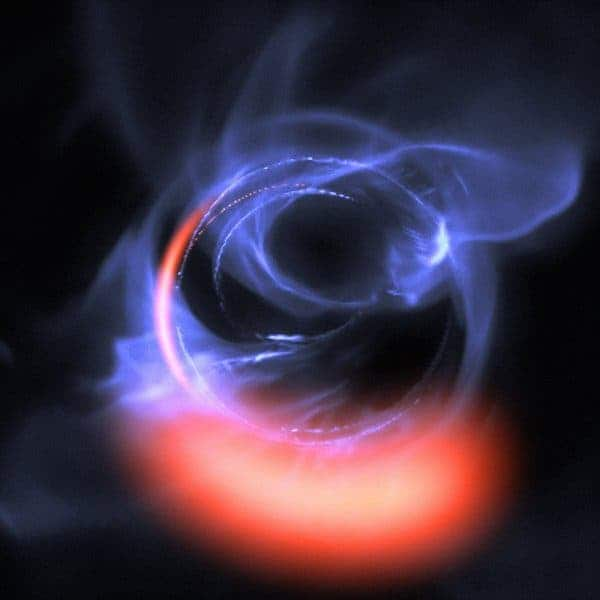 Illustration of hot clumps of gas that orbit the black hole at the center of the Milky Way. Credit: ESO/Gravity Consortium/L. Calçada.