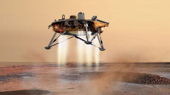 Artist impresion of the InSight probe gently touching down on Mars with its descent engines fired on. Credit: NASA.