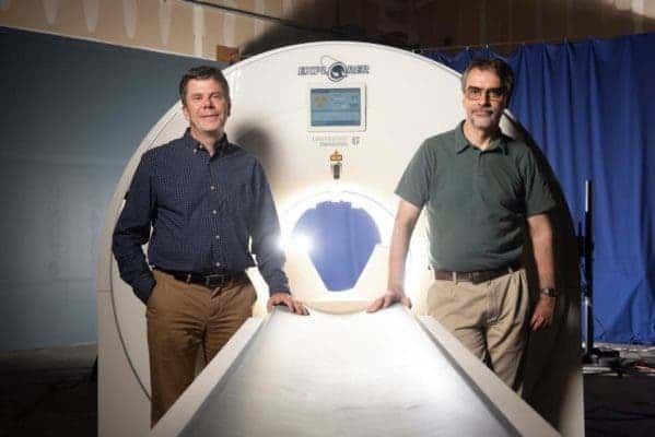 Simon Cherry (left) and Ramsey Badawi with a mockup of the EXPLORER total-body scanner. Credit: Lisa Howard/UC Davis.